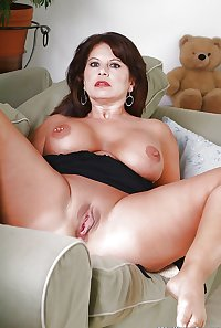 Older mature brunette MILF babe with pierced nipples