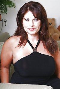 Older mature brunette MILF babe with pierced nipples